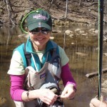 Adaptive Guide:Donna tying on a little fly.