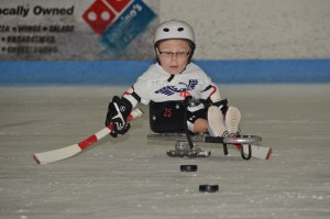 Tripp Ryder - Racing for a loose puck!